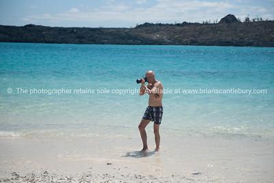 Rolf, getting the money shot.          www.blurb.com/b/3551540-galapagos-islands