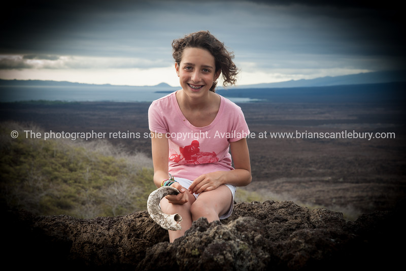 """Fransesca, sitting atop the highest point in Galapagos.<br /> <br />            <a href=""""http://www.blurb.com/b/3551540-galapagos-islands"""">http://www.blurb.com/b/3551540-galapagos-islands</a>"""