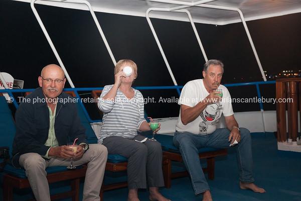 """On board, Rolf, Helen, Keith.           <a href=""""http://www.blurb.com/b/3551540-galapagos-islands"""">http://www.blurb.com/b/3551540-galapagos-islands</a>"""