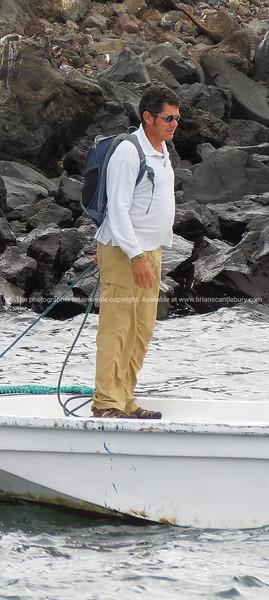 Fabian on the dinghy.          www.blurb.com/b/3551540-galapagos-islands