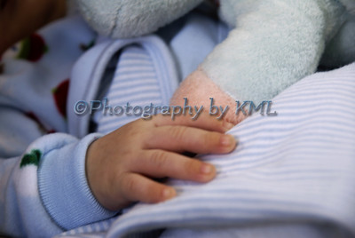 the hand of a sleeping baby