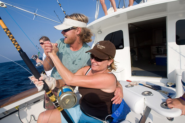 An angler is congratulated on a billfish triple play;  a white marlin, blue marlin and sail fish while fishing on an amazing fishing day aboard the Qualifier out of Oregon Inlet.