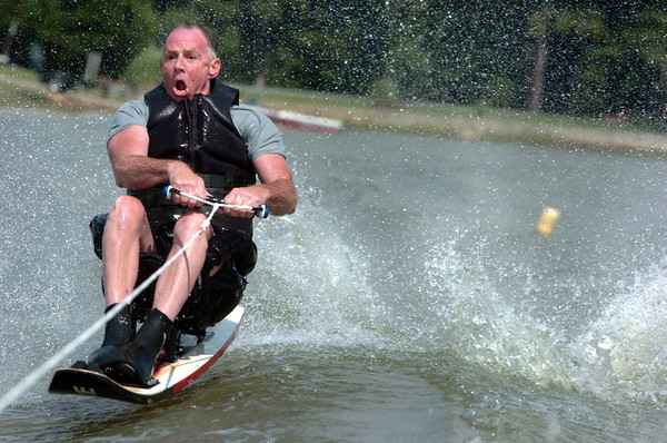 Athlete Ron Curll, a parapalegic, skiis on a special designed ski at Lake Kristi, just before the children from the Building Hope Community Life Center arrive Friday afternoon.  (Jenni Farrow)
