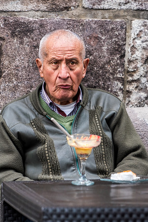 Man at Table Watching Political Rally Quito Copyright 2020 Steve Leimberg UnSeenImages Com _DSC5313