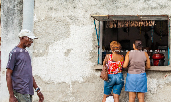 """Shop, opening in wall or """"hole in wall"""" in havana street.<br /> Model Release; No. Editorial or personal use only."""
