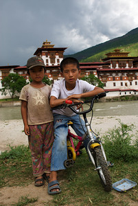 Striking a pose in front of the Punakha Dzong. Punakha, Bhutan