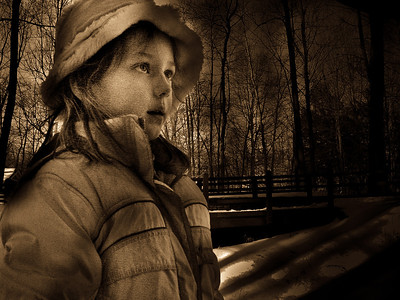 My daughter, ready for the winter.  I didn't like the pink in her jacket, so I used Antique in Lightroom.  I hope you like the effect.  I have been going through my old images, since I now have Lightroom.  I love the artistic creativity provided by the software, but I still like realism...