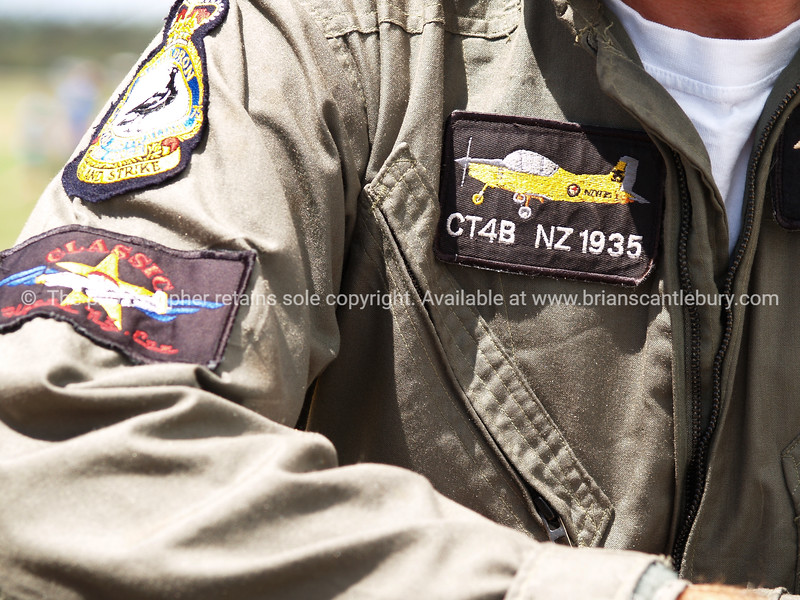 Pilot flying suit displaying badges. Model Release; No. Editorial or personal use only.