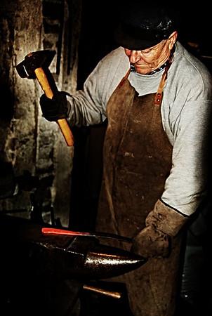 Finnish blacksmith working.
