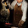 Finnish blacksmith working.