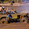 People jumping from a Mud Bog racing truck whose engine has caught fire Florida