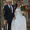 The bride with her father, anxious to walk down the aisle.