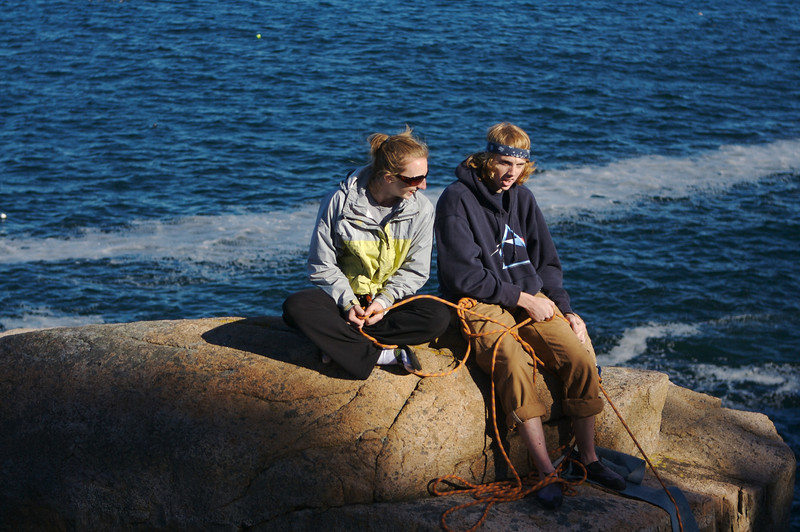 Luke and Jen belaying from the sea stack at Otter Cliffs, Acadia National Park, ME