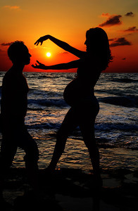 Pregnency pictures on Gash Shore line at sunset