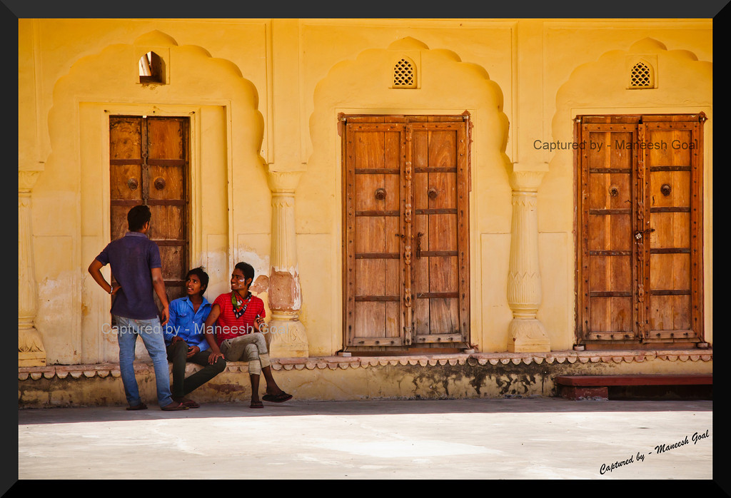 Young men having a good time inside the Amber (Amer) Palace, Jaipur (Rajasthan)