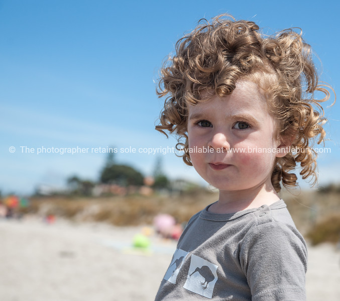 Curly hair, child at beach.<br /> Model release; yes.