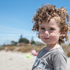 Curly hair, child at beach. Model release; yes.
