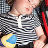 Child asleep in pushchair.<br /> Model release; Yes.