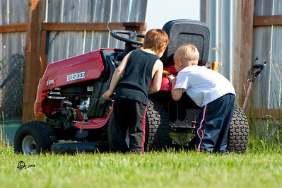 Young boys checking out machinery