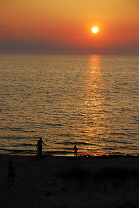 Folks never tire of Lake Michigan sunsets (Covert, MI).