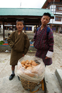 Young salesmen at the market in Paro, Bhutan.