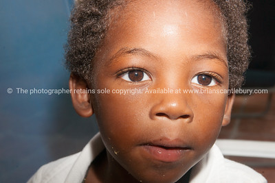 Closeup, young black boy, wide eyed. Model release; No.