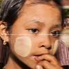Young girl with thanaka patches on cheeks. Myanmar Travel Images
