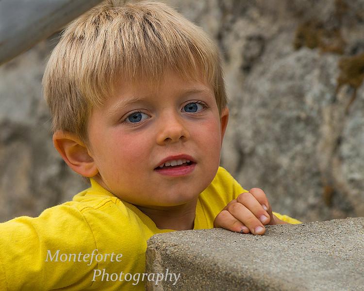 Boy climbing steps at Hiroshima peace memorial at Lovers Point PG