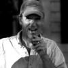 A man lights a celebration cigar
