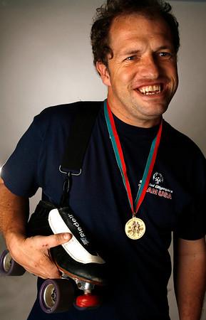 Special Olympic athelete Chris Richards poses with his skates.  (Jenni Farrow)