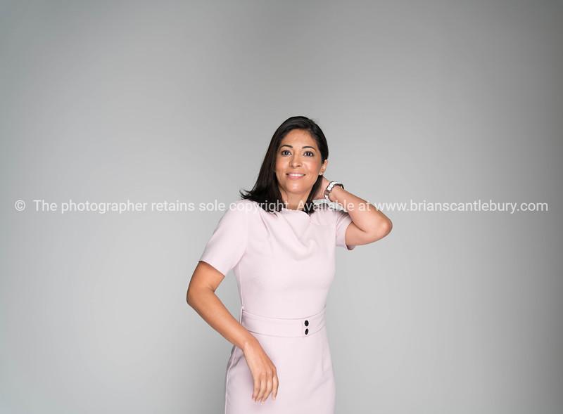 Professionally dressed wonam in pink
