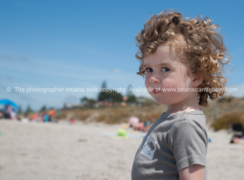 Indignant, boy with curly hair.<br /> Model release; Yes.