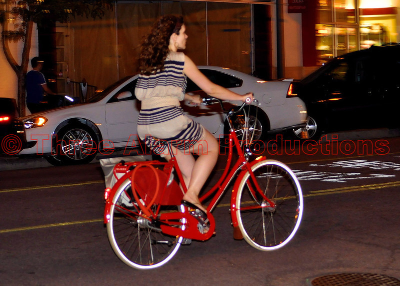 A bicyclist cruising downtown Tejon Street in Colorado Springs, Colorado, USA.