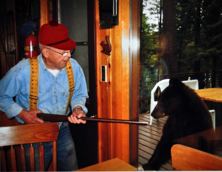Al showing his shotgun to a bear.