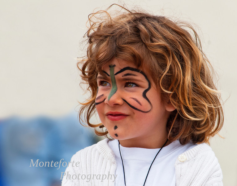 Girl with painted face at the Turkish festival, Monterey Ca.