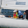 Racing sailboat crew ready for a manouver