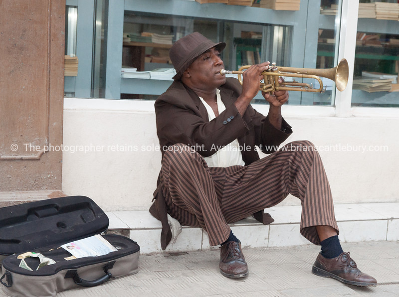 Trumpeting Busker in Havana, Cuba.<br /> <br /> Model Release; No. Editorial or personal use only.