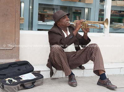Trumpeting Busker in Havana, Cuba.  Model Release; No. Editorial or personal use only.