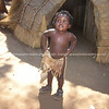 "Cuet black kid looks up at photographer in a ""Tourist Village"". Model Release; No. Editorial or personal use only."