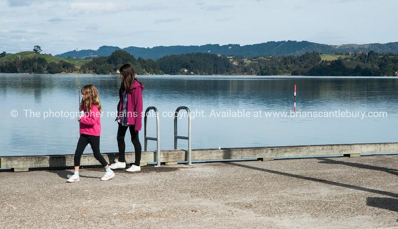 children on Ohiwa wharf.<br /> Model Release; no