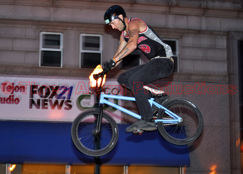 """Maximum Velocity"" Bicycle Stunt Team performing at the Opening Olympic Ceremony Celebration in downtown, Colorado Springs, Colorado, USA.<br /> See their website at: <a href=""http://mvst.com/"">http://mvst.com/</a><br /> Join them on Facebook at: <a href=""https://www.facebook.com/pages/Maximum-Velocity/29154944120"">https://www.facebook.com/pages/Maximum-Velocity/29154944120</a>"