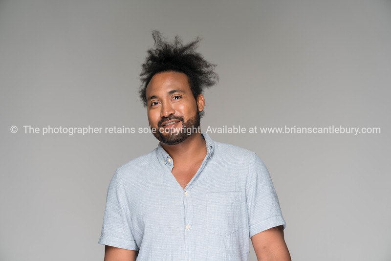 Black man with frizzy hair in knot