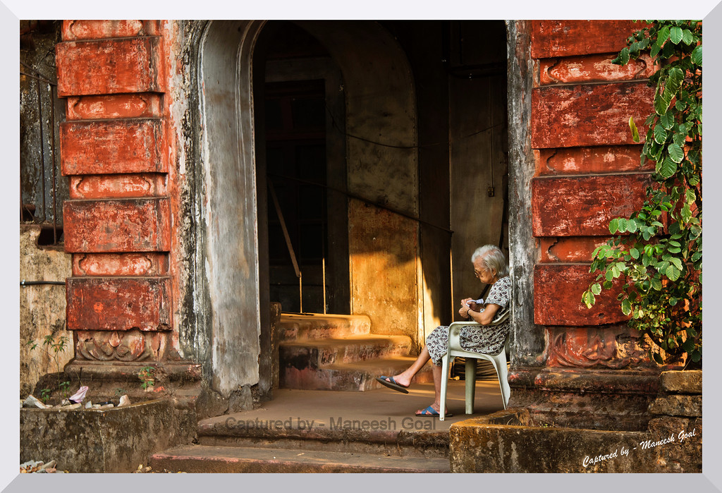 An era gone by...An old lady knits sweater on the steps of her dilapidated Portuguese styled mansion! (Margao)<br /> <br /> Goa, an erstwhile Portuguese colony (until 1961), still retains a lot of its culture, food, architectural style, language, mannerisms... and, of course, its love for football!