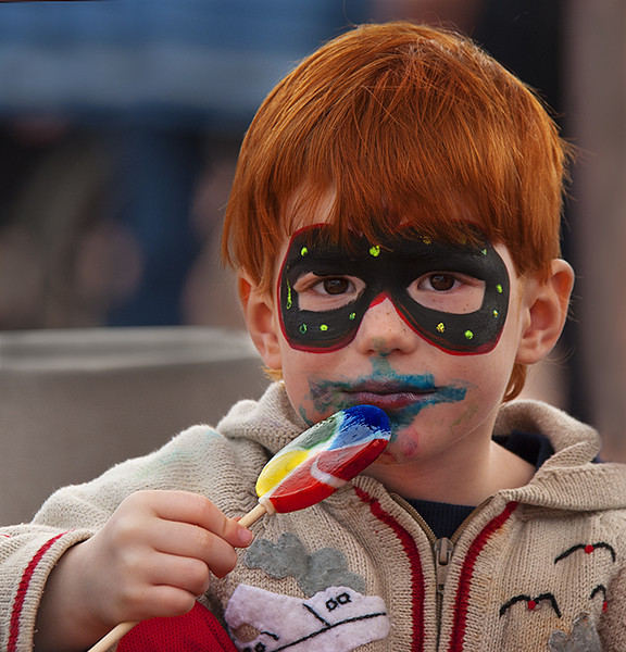 Masked bandit eating lollypop.