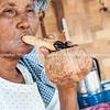 Burmese woman smokes large cigar. Myanmar Travel Images