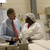 Senator Richard Burr made his way around the Grady White Boat facility Friday afternoon shaking hands and talking with workers during his visit, seen here with Laura Barfield at her hinging station.  (Jenni Farrow)