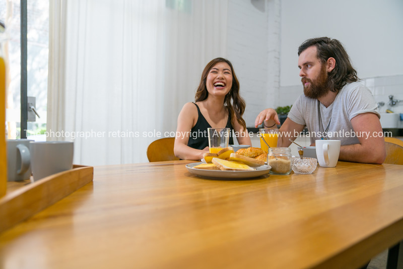 Young couple at breakfast table.