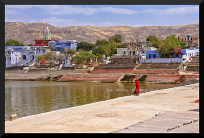 Ablution! A woman readying to take a dip in the holy waters of Pushkar Lake