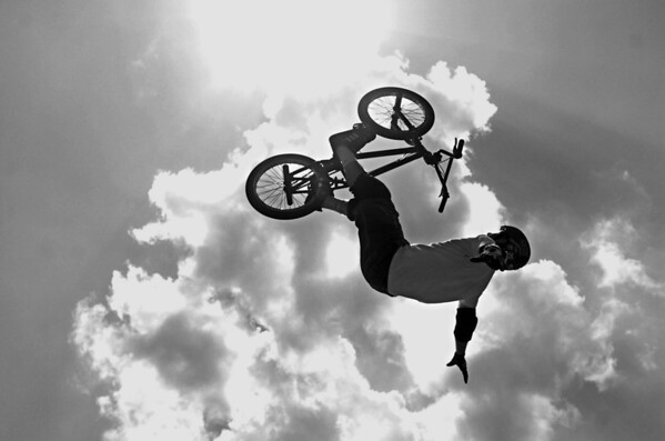 BMX Rider, Ryan Nyquist, soars through the air during a demonstration at Jaycee Skatepark's re-opening of the bike ramps.  Published 5/7/06 (Jenni Farrow)