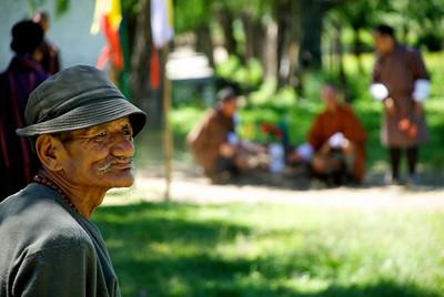 Darts spectator. Paro, Bhutan